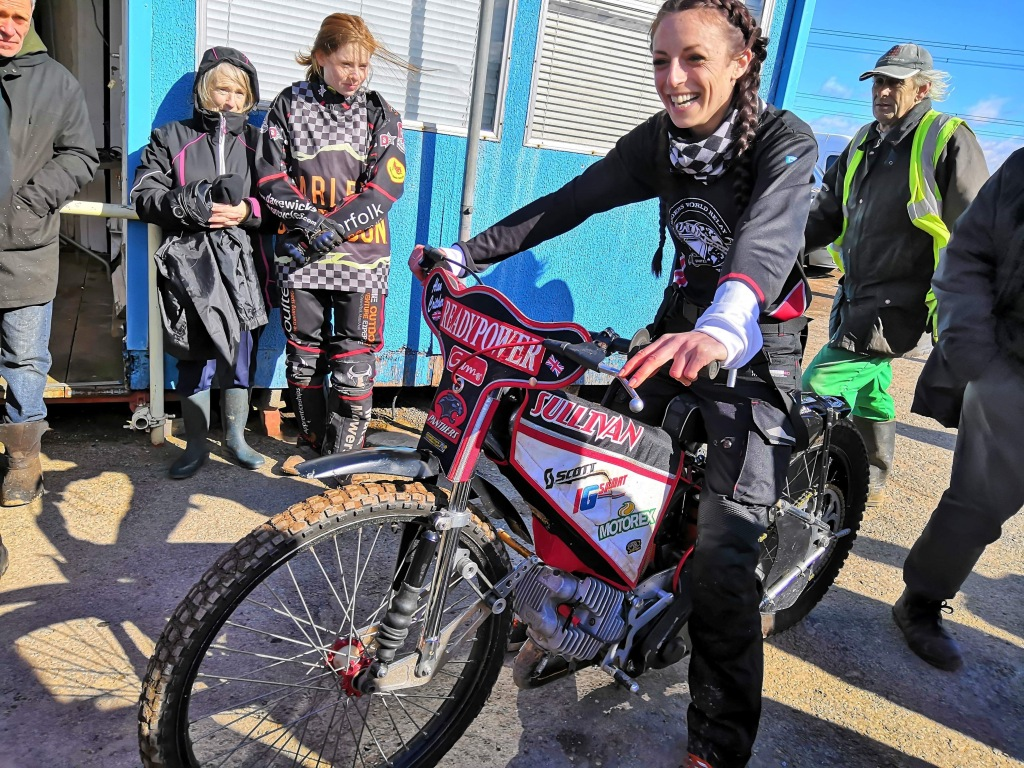 Hayley Bell WRWR founder on a dirt bike