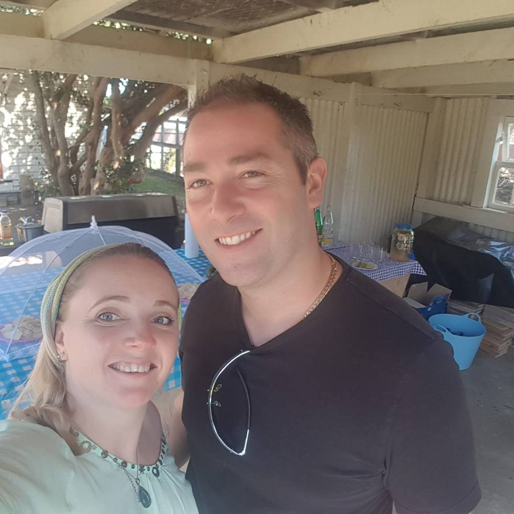 My husband and I at our house warming in New Zealand